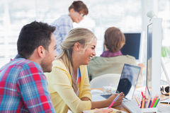 Designers laughing and working together Stock Image