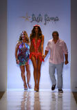 Designers Lourdes Hanimian (L) and Augusto Hanimian (R) walk the runway with a model during Luli Fama show at MBFW Swim 2015 Royalty Free Stock Images