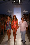 Designers Lourdes Hanimian (L) and Augusto Hanimian (R) walk the runway with a model during Luli Fama show at MBFW Swim 2015 Royalty Free Stock Photo