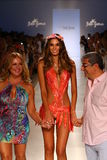 Designers Lourdes Hanimian (L) and Augusto Hanimian (R) walk the runway with a model during Luli Fama show at MBFW Swim 2015 Stock Photography