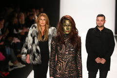 Designers Michael and Stephanie Costello with model (c) walks the runway at the Art Hearts Fashion show during MBFW Fall 2015 Stock Images