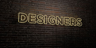 DESIGNERS -Realistic Neon Sign on Brick Wall background - 3D rendered royalty free stock image Stock Images