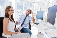 Designers sitting at their desk Royalty Free Stock Image
