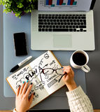 Designers table with notes and tools, above.  royalty free stock images