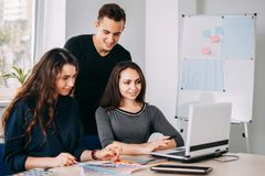 Designers team discussing new project at studio stock image