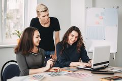 Designers team drawing working with color samples royalty free stock photography