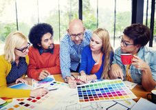 Designers Working and Brainstorming in a Meeting Stock Photo