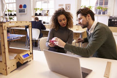 Designers Working With 3D Printer Discuss Prototype Royalty Free Stock Photography