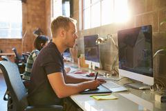 Designers Working At Desks In Modern Office Stock Photography