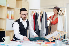 Designers working in fashion studio Stock Photo
