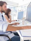Designers working hard at their desk Royalty Free Stock Photography