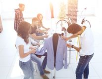 Designers working on new models of clothes Royalty Free Stock Images