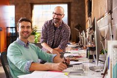 Designers Working Together At Desks In Modern Office stock photos