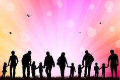 designfamiljbilden silhouettes ditt Arkivfoto