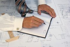 Designing. Engineer-designer develop  technical design construction new building Royalty Free Stock Photos