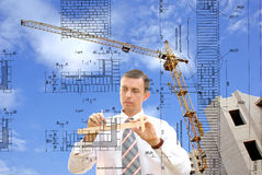 Designing. Serious engineer-designing resolve compound architectural problem royalty free stock image
