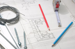 Designing. Pencils, tape measure and other tools on top of a plan stock photos