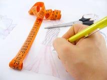 Designing. Work table of a fashion designer Stock Photo