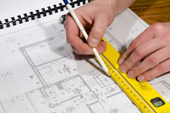 Designing a building. With pencil and paper stock image