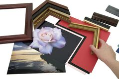 Designing frame project. Deciding on a framing project with an assortment of colored matboard and frame samples - path included Stock Photos