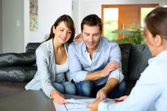 Designing home. Couple meeting consultant for financial contract