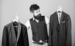 Designing made to measure suit. Custom made suit. Man bearded fashion couturier tailor. Elegant custom outfit. Tailoring. And clothes design. Perfect fit stock photography