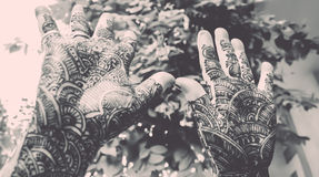 Designing mehandi showing by hands up - retro look. Hands up with mehandi on both hands Stock Photography