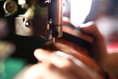 Designing shoes, occupation shoemaker. Elegant but masculine, manual precision work shoemaker stock photography