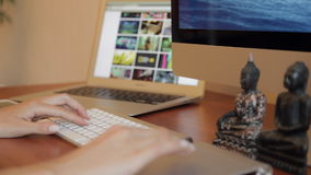 Designing at Wood Desk with Wireframe and Computer stock footage