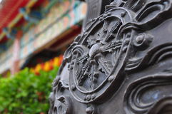 Designs on old sculpture beside temple Stock Photo