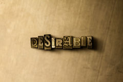DESIRABLE - close-up of grungy vintage typeset word on metal backdrop Royalty Free Stock Images