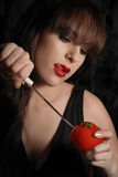 Desire. The young beautiful girl cuts a tomato Royalty Free Stock Photo