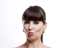 Desire. Close-up portrait of a woman with closed lips, isolated on white background Royalty Free Stock Image