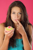 Desire of a cake series. Portrait of a young girl with cream pastry Royalty Free Stock Photos
