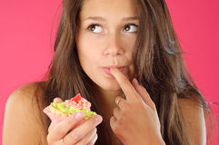 Desire of a cake series. Portrait of a young girl with cream pastry Stock Image