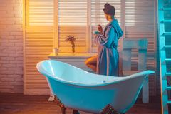 Desire and seduction. Massage and spa salon concept. naked woman going to take shower. girl with body relax in bath. Near tub. relax in bathroom in the morning Royalty Free Stock Image