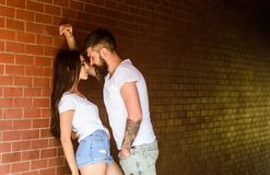 Desire and temptation. Couple in love full of desire brick wall background. Couple find place to be alone. Couple enjoy. Intimacy moment without witnesses. Girl stock photos