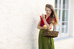 Desire to take one bite from basket. Passing by with basket of juicy apples Stock Image