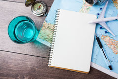 Desire to travel , trip vacation, tourism mockup. Travel , trip vacation, tourism mockup - close up of compass, glass of water note pad, pen and toy airplane and royalty free stock photo