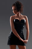 Desired brunette woman posing in leather corset Stock Photography