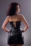 Desired brunette woman posing in leather corset Stock Photo