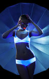 Desired Girl with glow make-up portrait. Disco Girl with neon make-up glow dance in dark portrait Stock Image