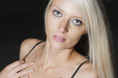 Desiring Blue Eyes. Beautiful blonde looking longingly in to the camera Stock Photo