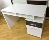Desk. White desk with trays on laminate floor Stock Image