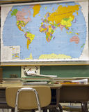 Desk. In front of classroom map royalty free stock photos