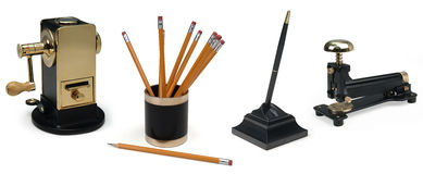 Desk accessories on white. Pencil sharpener, pencils, pen, stapler on white background Stock Photography