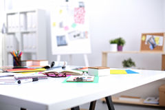 Desk of an artist with lots of stationery objects Royalty Free Stock Photos