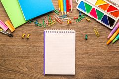 Desk of an artist with lots of stationery objects on wooden background stock photography