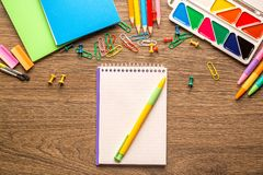 Desk of an artist with lots of stationery objects on wooden background stock images