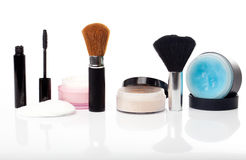 Desk of beauty products. Miscellaneous collection of beauty products and make-up elements Royalty Free Stock Photo
